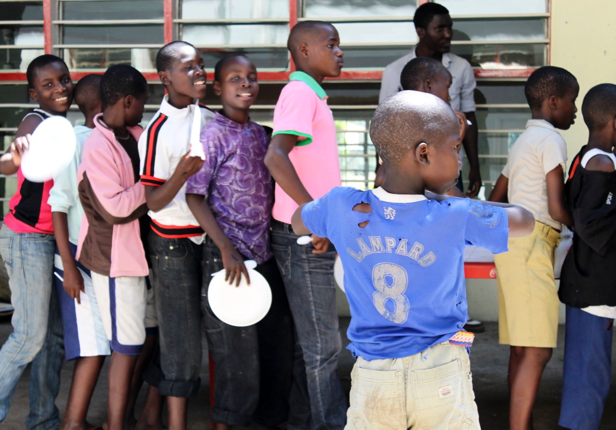 Queing for food at Isamilo International School's Saturday School Christmas Party in Mwanza, Tanzania..