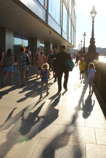 Shadows of the Dunnells walking along the South Bank in London