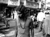 Sadhu walking along a street in Banaras, India