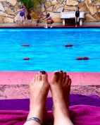 Resting by the pool while the kids play at the Collo
