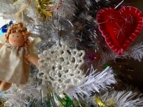 Crochet snowflake made from plastic bags hanging on our Christmas tree