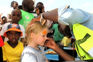 Frida having her face painted at Heading down the home straight at Ngong Racecourse in Nairobi