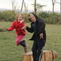 Lottie and Leon mid jump at Fishermans Camp, Lake Naivasha