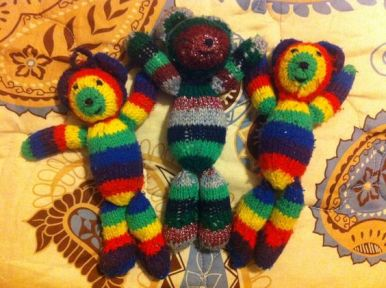 Three knitted rainbow mice my three babies