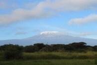 Clouds clearing to reveal Mount Kilimanjaro at Amboseli Sopa Lodge in Kenya