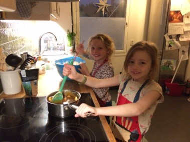 Lottie and Frida mixing up the ingredients for the gingerbread house