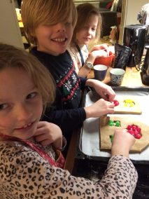 Adding the boiled sweets to the windows before baking the gingerbread house