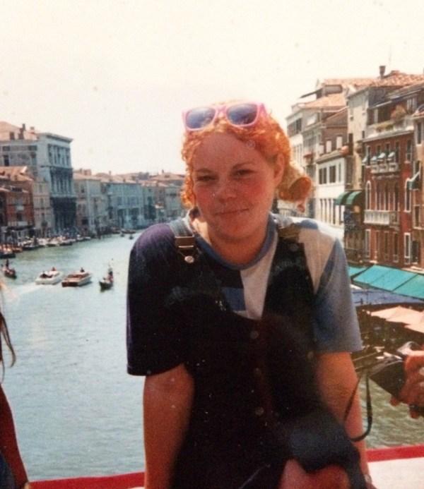 Ali on the Rialto Bridge over looking the Grand Canal in Venice