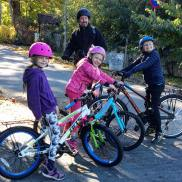 Family cycle ride in Spånga, Sweden