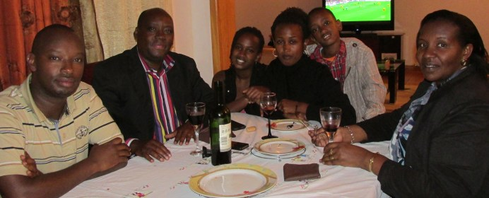 With Angelique and Jean-Paul and their family in their home after a delicious meal.
