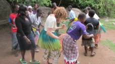 Me dancing with local women.