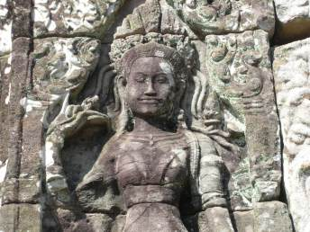 Delicate stone carving of a woman in Angkor Wat