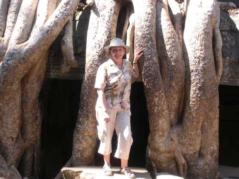 Talek before huge tree roots in Angkor Wat
