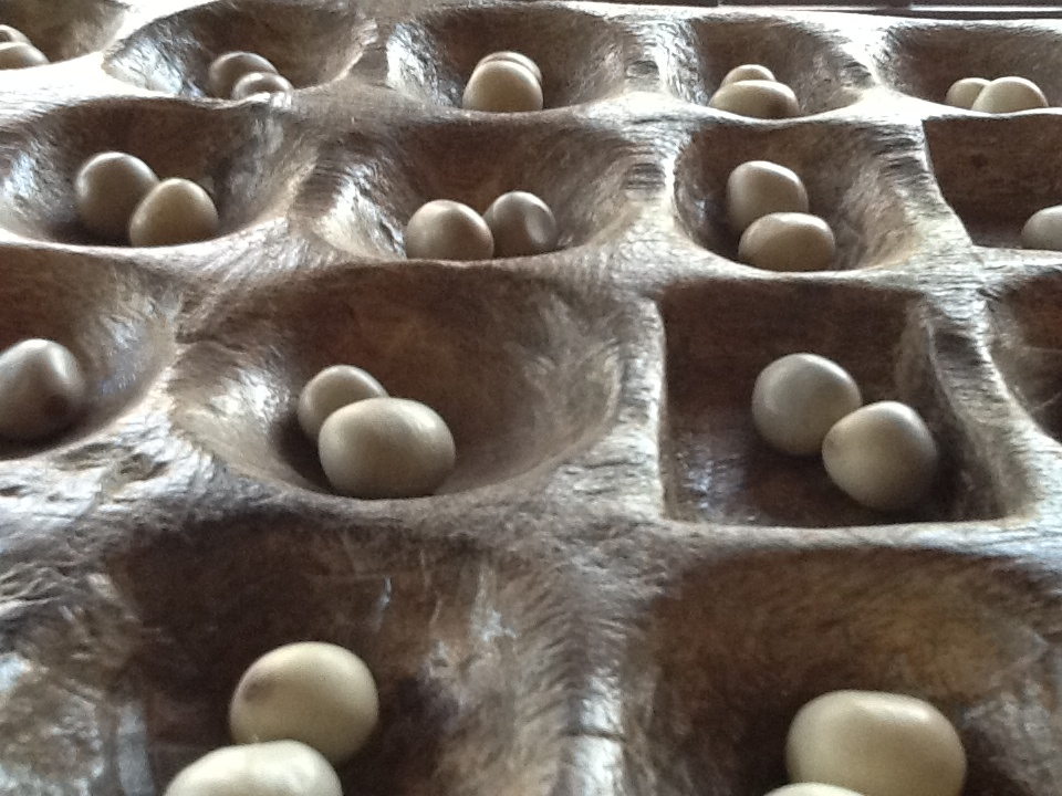 Mancala board game in Mozambique