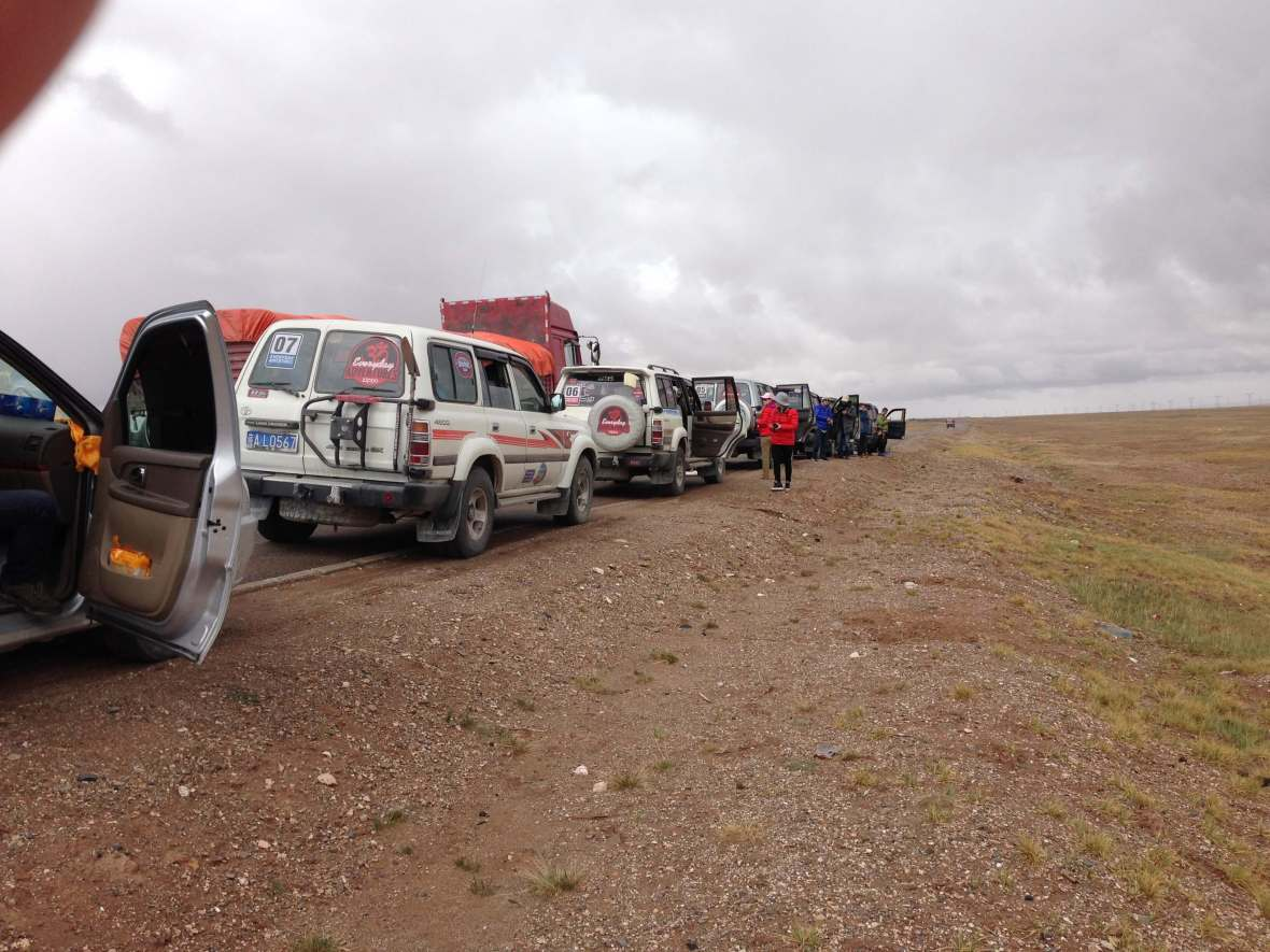 Row of Toyota Land Cruisers stopped for a rest on the journey to Tibet
