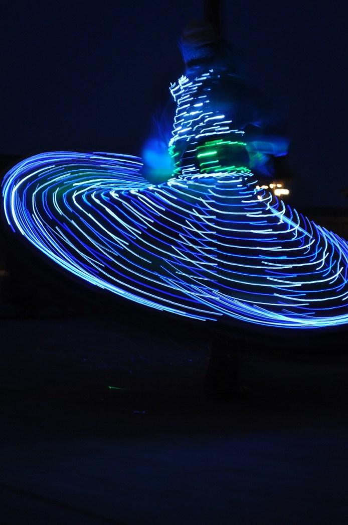 Whirling dervish in Dubai desert.