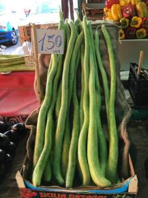 Six foot high zucchini in a Palermo market.