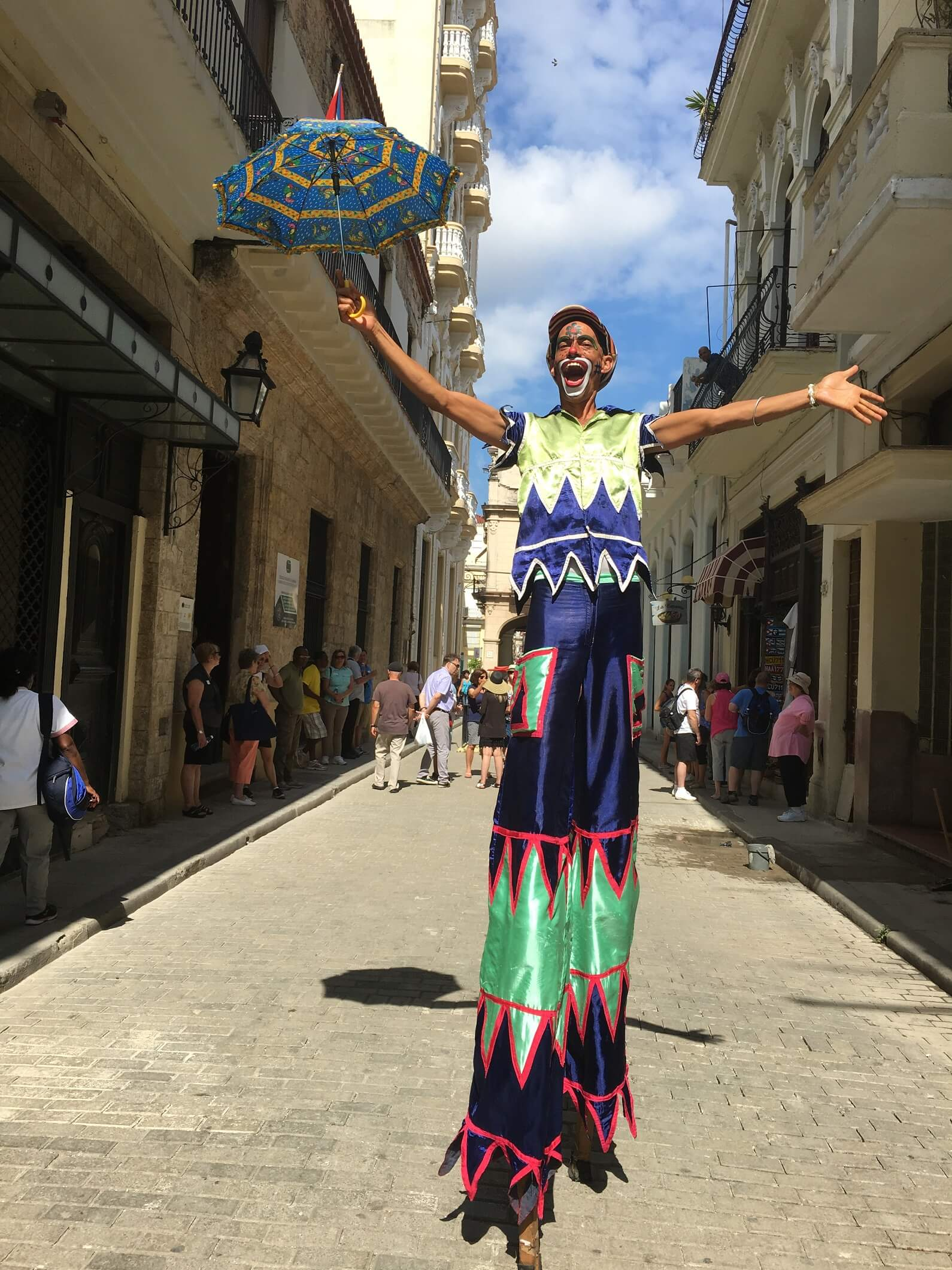 Visit Havana and see man on stilts in Havana street