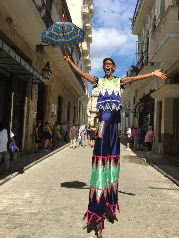 Man on stilts in Havana street