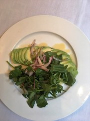 Avocado and watercress, a traditional Cuban side dish.