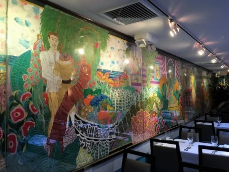 The colorful mural at Victors Cafe.
