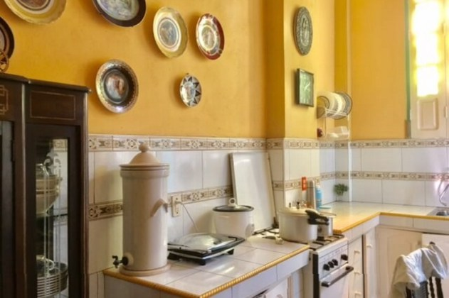 Cuban kitchen you'll see in a casa on your trip to Cuba