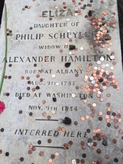coins on one of the most famous graves in the USA