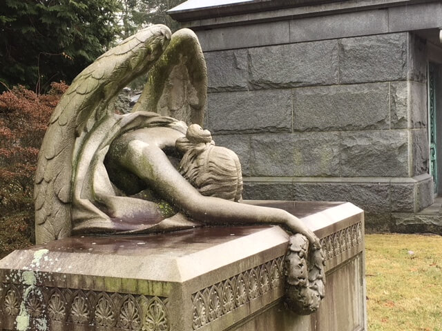 crying angel in Woodlawn, one of the famous cemeteries