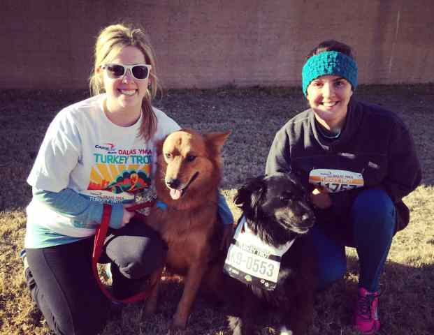 Ally and Carisa with their dogs at the Turkey Trot 5K