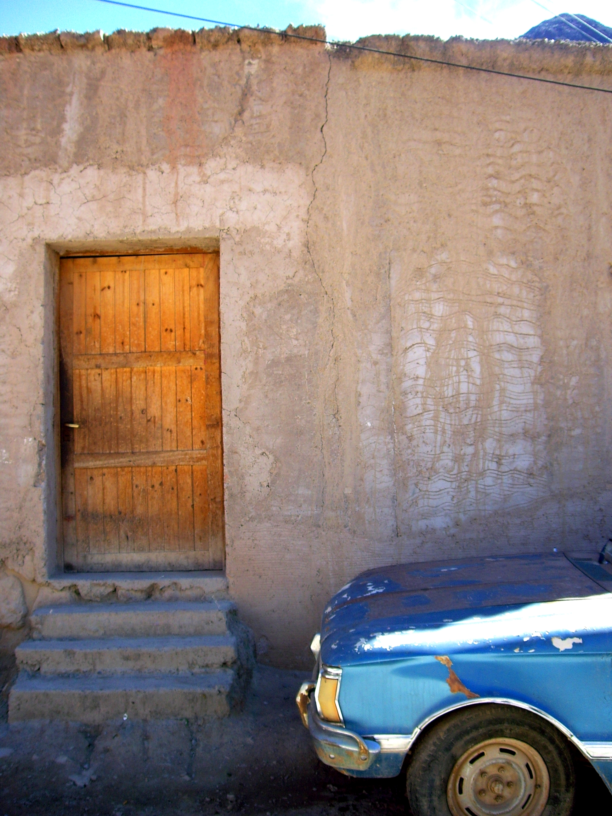 Car and window, Purmamarca, Argentina