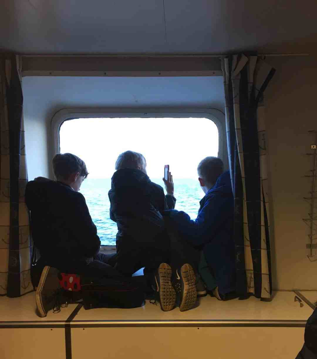 Kids watching out a ferry window