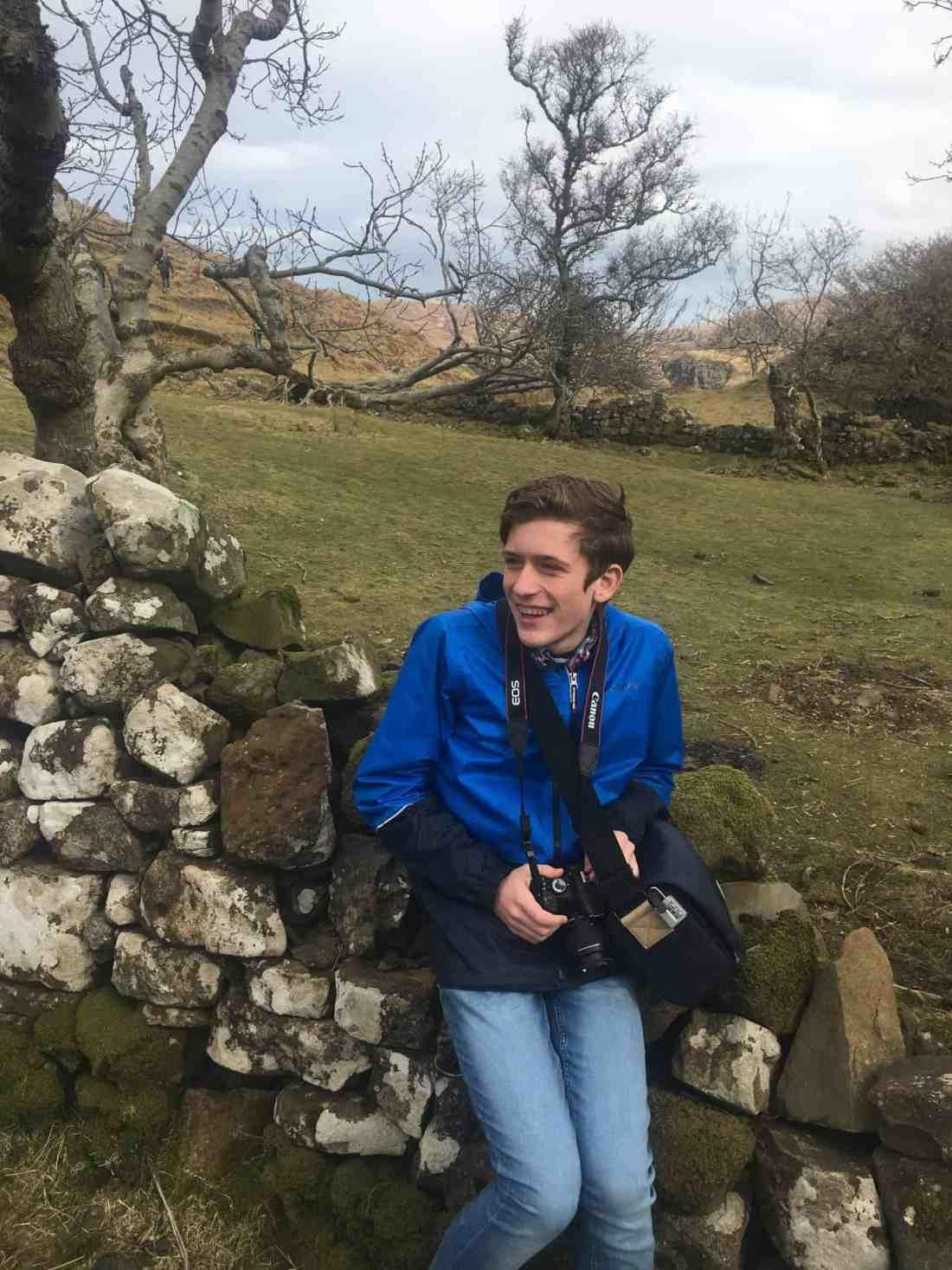 moss covered rock wall in fairy glen