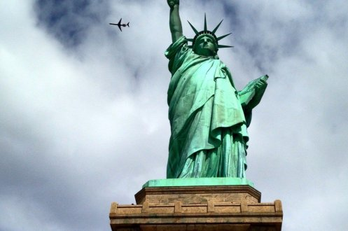 Statue of Liberty with plane in sky