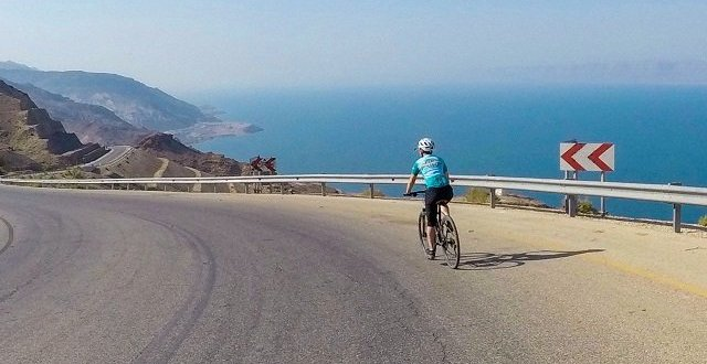 Cyclist in Jordan overlooking the Dead Sea