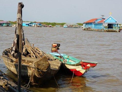 Tonle Sap floating village home and church on tonle Sap lake near Siem Reap Cambodia