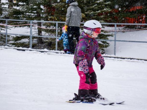 girl skiing on a family ski holiday