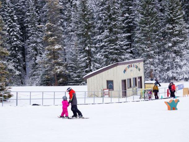 child and instructor ski lesson Banff Mount Norquay