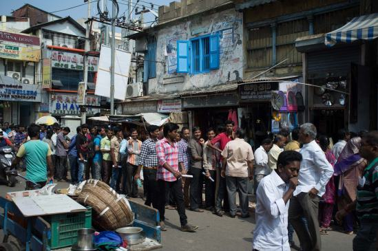 People queuing outside a Chennai bank, who knows if they'll reach the front before the money runs out.