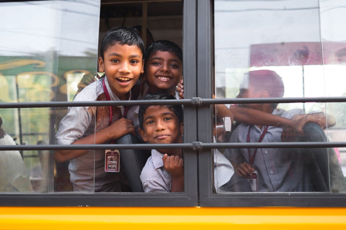 Kids on a school bus in Alleppey.