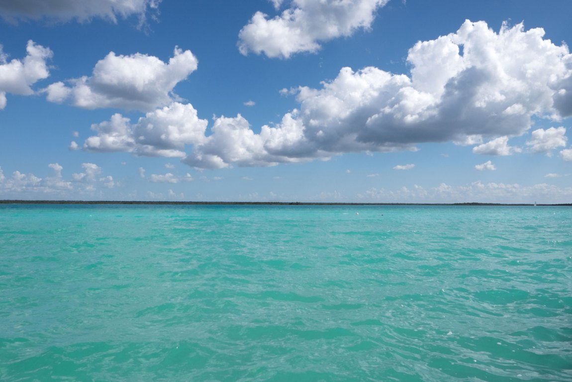 Blue water and blue sky in Bacalar, Mexico.