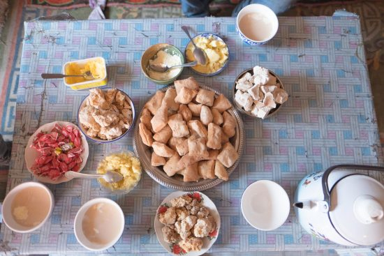 A table of dairy products and boortsog in Mongolia.