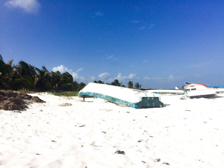 Upturned boats on Tulum beach, Tulum, Mexico