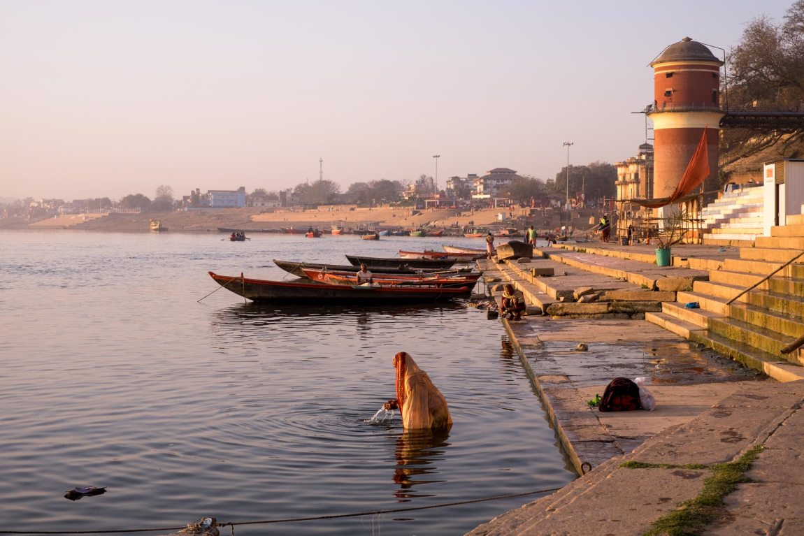 A woman bathes in the river Ganges.