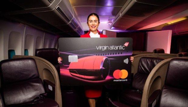 Virign credit cards held by young female