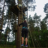 climbing up to the high ropes course