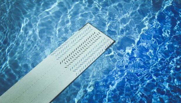 springboard over blue water
