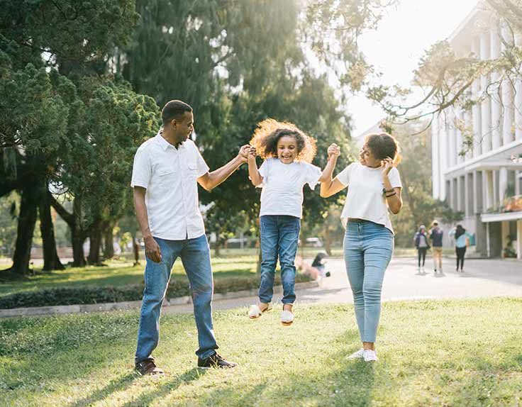 A young family having fun in park