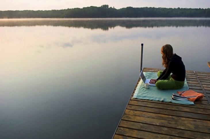 Travelancing Girl on Dock by Lake