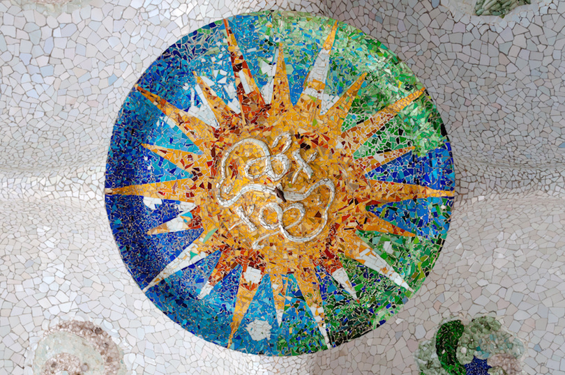 Season mosaic with orange sun at sala Hipostila in Park Guell at Barcelona