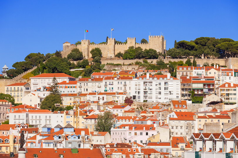 Sao Jorge castle over the old rooftops of Lisboa, Portugal